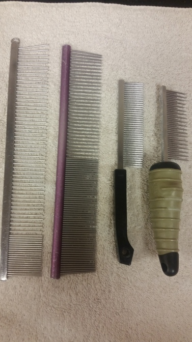Metal combs are great for medium to long coats. The wider the teeth the easier it is to break up tangles.